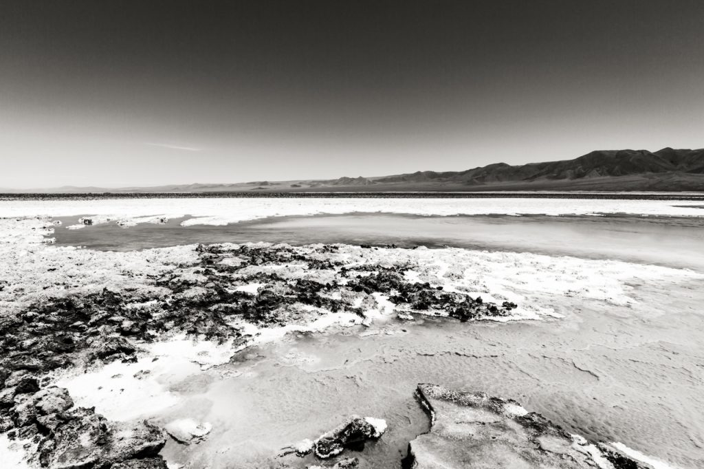 Rocks jutting out of Laguna Baltinache in black and white
