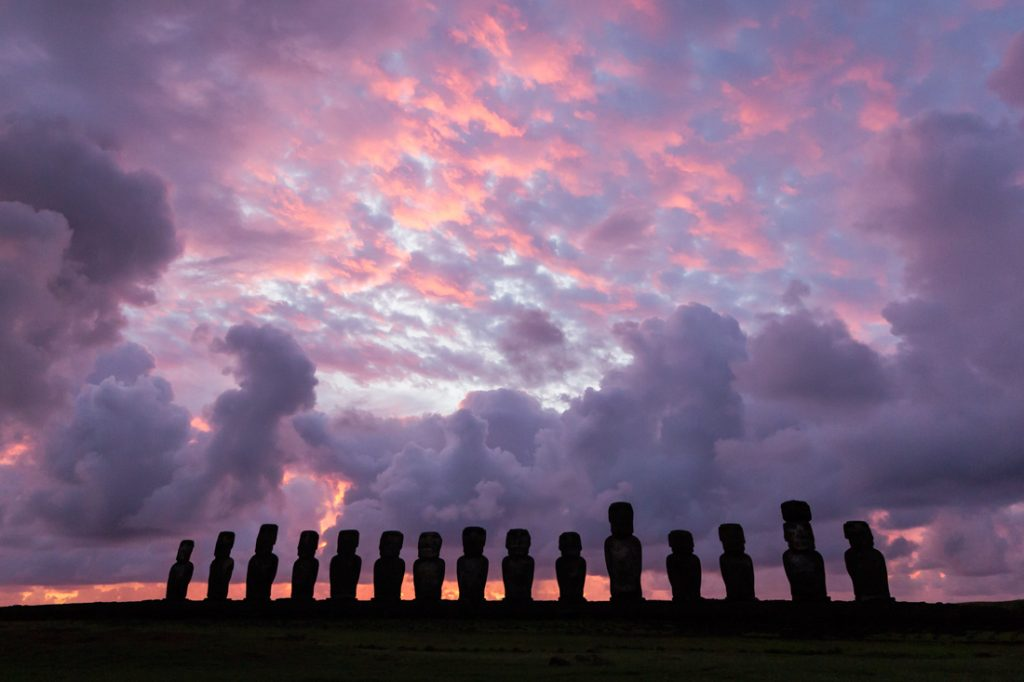 Line of moai statues at Ahu Tongariki at sunrise on Easter Island