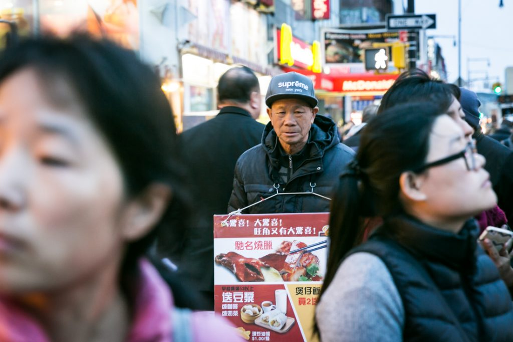 Sign board man in Flushing, Queens