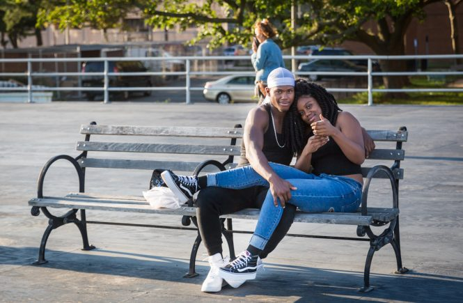 Coney Island street photography of lovers taking a selfie on the boardwalk