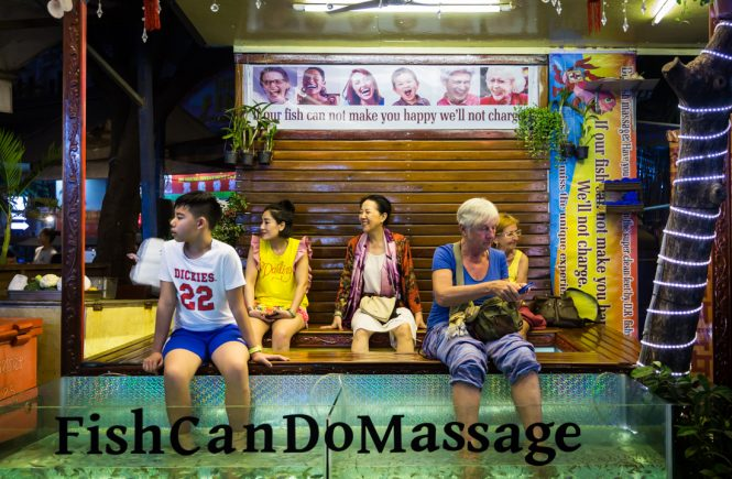 Tourists getting a fish massage for an article on Siem Reap travel tips