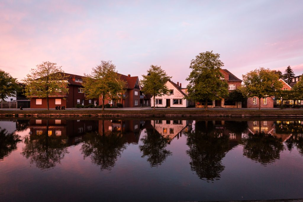 Houses on a canal in Papenburg, Germany at sunset