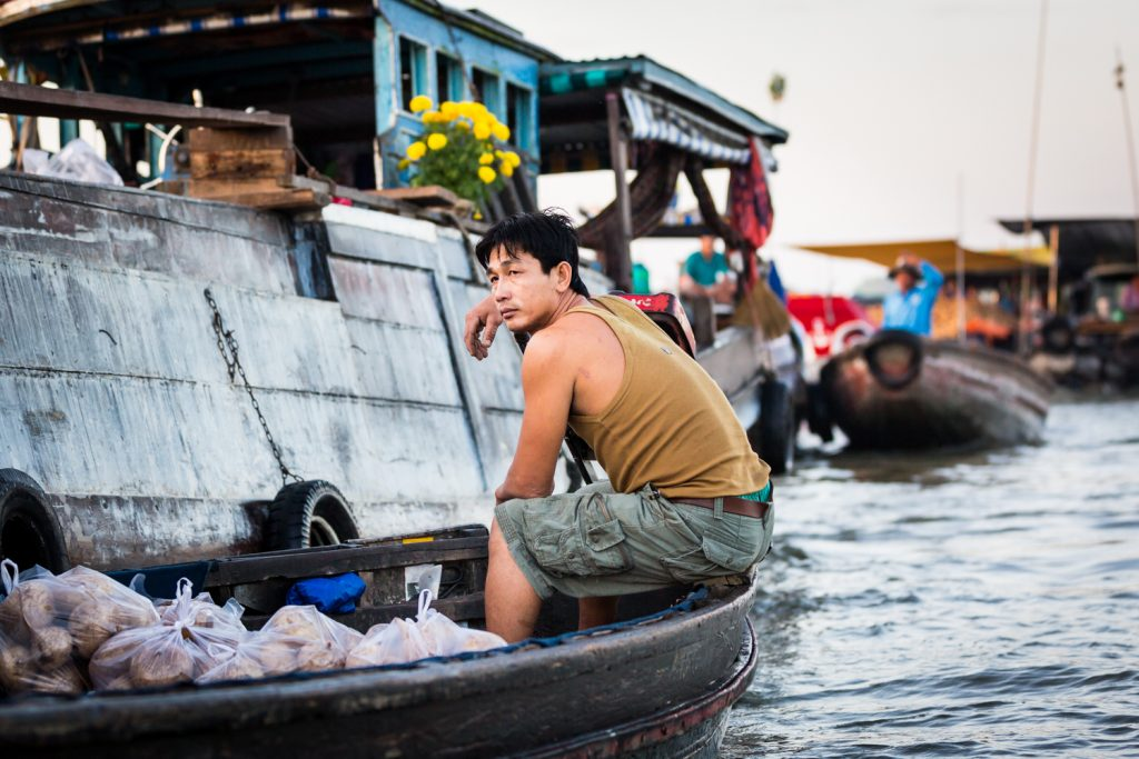Worker in boat at the Cai Rang Floating Markets