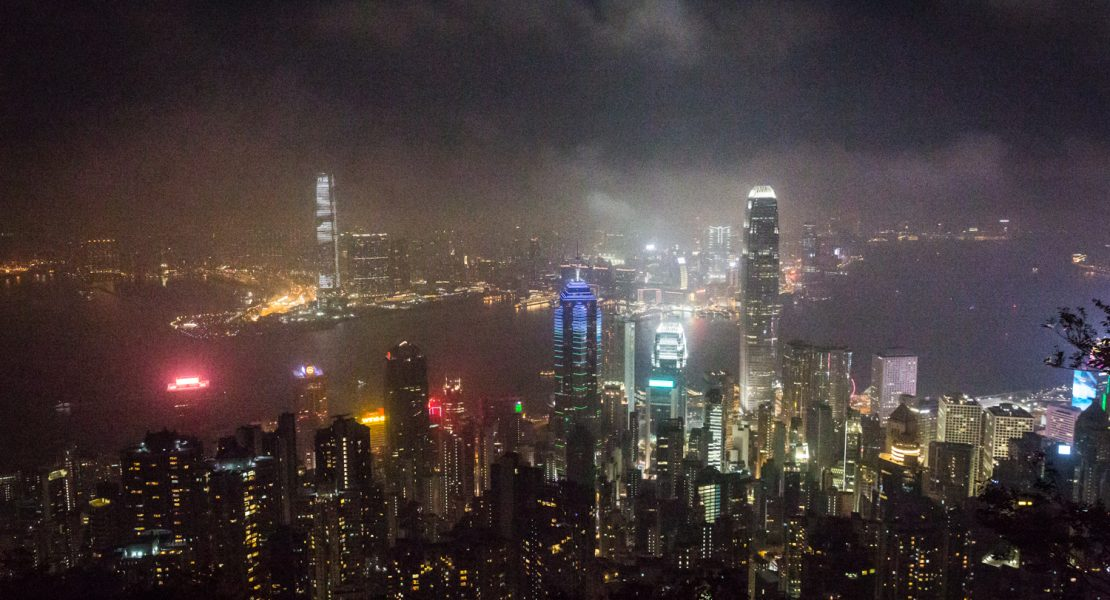 Night view of skyscrapers for a Hong Kong travel guide article