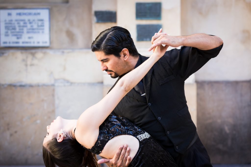 Male tango dancer dipping female tango dancer in Buenos Aires, Argentina